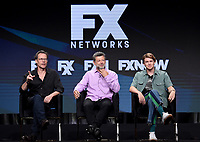 """BEVERLY HILLS - AUGUST 6: (L-R) Cast Members Guy Pearce, Andy Serkis, and Joe Alwyn onstage during the """"A Christmas Carol"""" panel at the FX Networks portion of the Summer 2019 TCA Press Tour at the Beverly Hilton on August 6, 2019 in Los Angeles, California. (Photo by Frank Micelotta/FX Networks/PictureGroup)"""