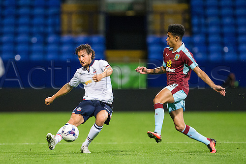 26.07.2016. Macron Stadium, Bolton, England. Pre Season Football Friendly. Bolton Wanderers versus Burnley. Bolton Wanderers defender Lawrie Wilson shoots past Burnley FC midfielder George Boyd.