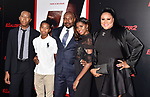 HOLLYWOOD, CA - JULY 17: Director Antoine Fuqua (C) and family attend the premiere of Columbia Picture's 'Equalizer 2' at TCL Chinese Theatre on July 17, 2018 in Hollywood, California.