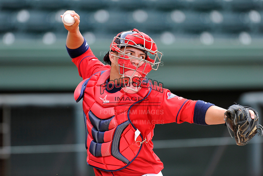 Catcher Carlos Coste (7) of the Greenville Drive on the team's preseason workout one day before Opening Day on Wednesday, April 2, 2014, at Fluor Field at the West End in Greenville, South Carolina. (Tom Priddy/Four Seam Images)