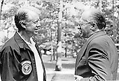 United States President Jimmy Carter, left, and Prime Minister Menachem Begin of Israel, right, chat in front of Birch Lodge at Camp David, the presidential retreat near Thurmont, Maryland, after taking a walk together on September 14, 1978..Credit: White House via CNP