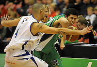 Jets' Logan Funnell tries to get past Lindsay Tait. NBL  - Manawatu Jets  v Wellington Saints at Arena Manawatu, Palmerston North, New Zealand on Friday 17 June 2011. Photo: Dave Lintott / lintottphoto.co.nz