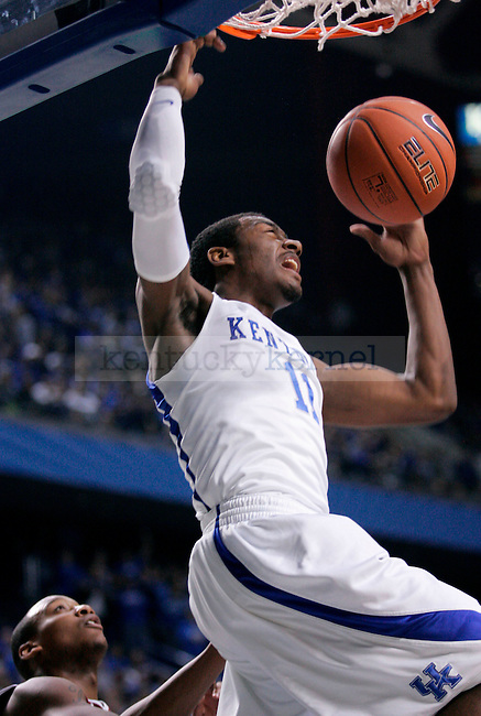 Freshman guard John Wall makes a basket during the first half of the game against the Rider Broncs at Rupp Arena on Saturday. Photo by Zach Brake | Staff