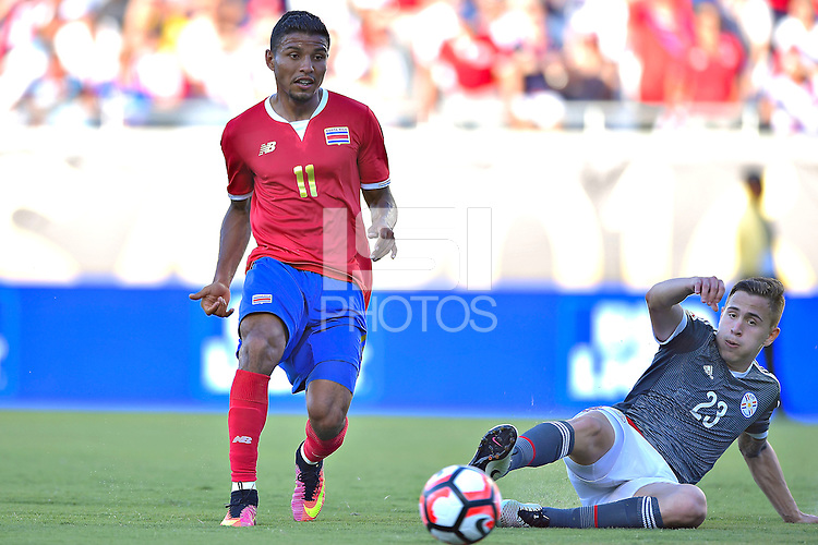 Action photo during the match Costa Rica vs Paraguay, Corresponding Group -A- America Cup Centenary 2016, at Citrus Bowl Stadium<br /> <br /> Foto de accion durante el partido Estados Unidos vs Colombia, Correspondiante al Grupo -A-  de la Copa America Centenario USA 2016 en el Estadio Citrus Bowl, en la foto: (i-d),  Johan Venegas de Costa Rica y Robert Piris de Paraguay<br /> <br /> <br /> <br /> 04/06/2016/MEXSPORT/Isaac Ortiz.