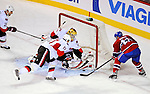 11 November 2008:  Ottawa Senators' goaltender Alex Auld makes a kick save against Montreal Canadiens' center and Team Captain Saku Koivu from Finland in the second period at the Bell Centre in Montreal, Quebec, Canada. The Canadiens, celebrating their 100th season, defeated the visiting Senators 4-0. ***Editorial Sales Only***..Mandatory Photo Credit: Ed Wolfstein Photo *** Editorial Sales through Icon Sports Media *** www.iconsportsmedia.com
