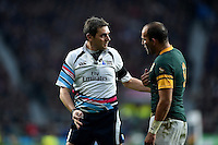 Referee Jerome Garces has a word with Fourie du Preez of South Africa during a break in play. Rugby World Cup Semi Final between South Africa and New Zealand on October 24, 2015 at Twickenham Stadium in London, England. Photo by: Patrick Khachfe / Onside Images