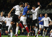 Kal Naismith climbing flanked by Derek Young (left) and Derek Lyle in the Rangers v Queen of the South Quarter Final match in the Ramsdens Cup played at Ibrox Stadium, Glasgow on 18.9.12.
