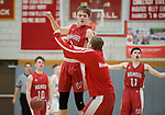WOLCOTT, CT-031418JS08- Wamogo's Sean Coffey (3) celebrates with a teammate after a time out is called during their win over East Hampton during their Division V semifinal game Wednesday at Wolcott High School. <br /> Jim Shannon Republican-American