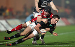 Johnathan Edwards tackles Dave McSharry..RaboDirect Pro12.Scarlets v Connacht.02.03.12.©STEVE POPE