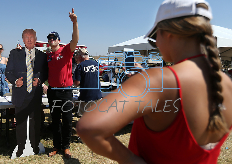Mackenzie Taylor take a photo of Brian Kehoe during the second annual Basque Fry in Gardnerville, Nev., on Saturday, Aug. 20, 2016. The Republican rally and Basque-style barbeque drew more than 1,000 people. Cathleen Allison/Las Vegas Review-Journal
