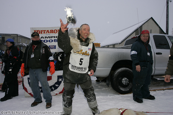Second place finisher Ed Iten tosses used dog booties to the crowd shortly after arriving in at the finish line in Nome.    End of the  2005 Iditarod Trail Sled Dog Race.