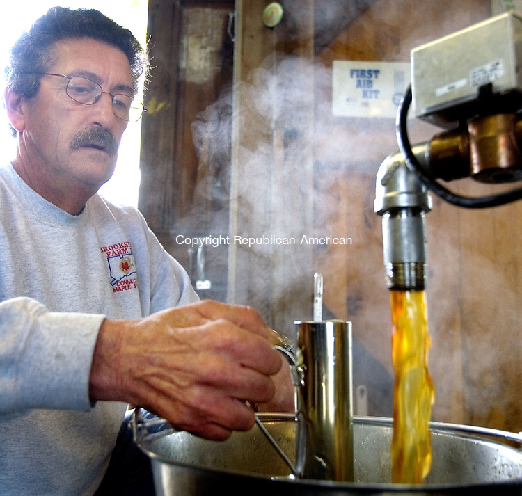 LITCHFIELD, CT. 01 April 2013-040113S15-John Langer checks the sugar content of maple syrup at Mark Harran's farm in Litchfield Monday. Harran is president of the Maple Syrup Producers Association of Connecticut..Steven Valenti Republican-American
