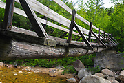 Side view of the Thoreau Falls Trail in the Pemigewasset Wilderness of New Hampshire. This bridge is in an area referred to as North Fork Junction and crosses the East Branch of the Pemigewasset River.