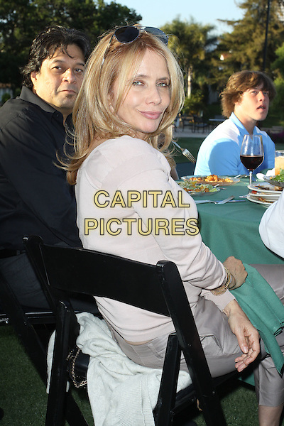 ROSANNA ARQUETTE  .Launch Of The Ann & George Lopez Foundation At The Third Annual George Lopez Celebrity Golf Classic_ Cocktail Dinner held At The Lakeside Country Club, Toluca Lake, California, USA..May 3rd, 2010.half length beige grey gray cardigan chair sitting looking over shoulder .CAP/ADM/KB.©Kevan Brooks/AdMedia/Capital Pictures.