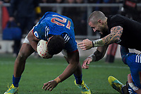 France's Wesley Fofana tries to get away from TJ Perenara during the Steinlager Series international rugby match between the New Zealand All Blacks and France at Forsyth Barr Stadium in Wellington, New Zealand on Saturday, 23 June 2018. Photo: Dave Lintott / lintottphoto.co.nz
