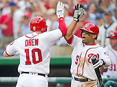 Washington Nationals shortstop Stephen Drew (10) celebrates his go-ahead pinch-hit home run in the eighth inning with teammate center fielder Ben Revere (9) during their game against the Chicago Cubs at Nationals Park in Washington, D.C. on Wednesday, June 15, 2016.  The Nationals won the game 5 - 4 in 12 innings.<br /> Credit: Ron Sachs / CNP
