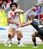 PICTURE BY CHRIS MANGNALL /SWPIX.COM...Rugby League - Super League  - St Helens Saints v Wigan Warriors  - Langtree Park, St Helens, England  - 06/04/12... St Helens Sia Soliola  tackled by  Wigans Thomas Leuluai