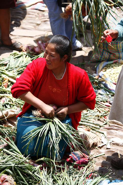 A vendor at the Pisac market hard at work.