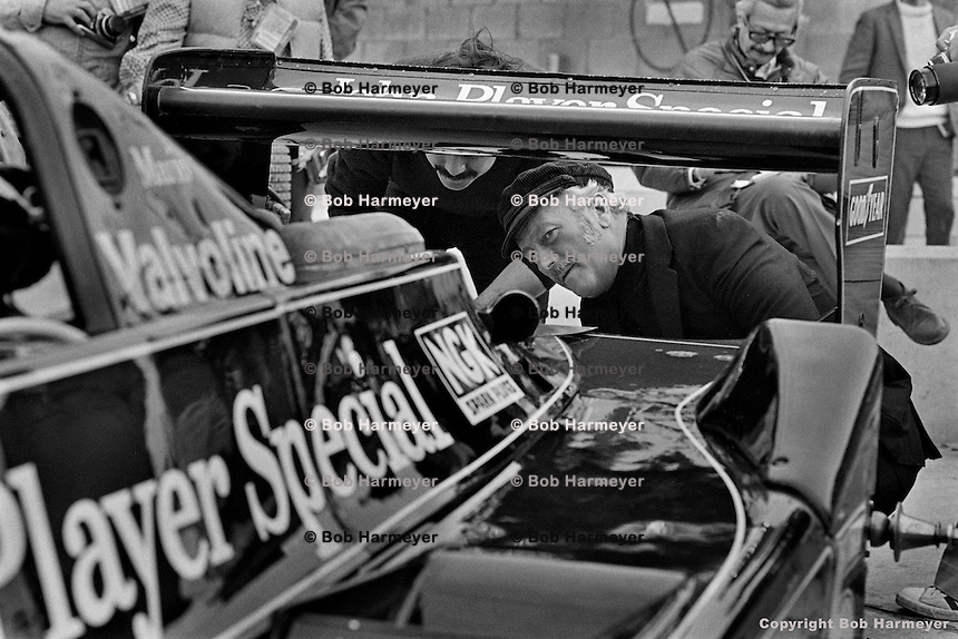 WATKINS GLEN, NY - OCTOBER 1: Colin Chapman inspects the back of Mario Andretti's Lotus 79 R3/Ford Cosworth DFV in the pit lane during practice for the United States Grand Prix East on October 1, 1978, at the Watkins Glen Grand Prix Race Course near Watkins Glen, New York.