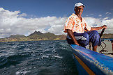 MAURITIUS, Trou D'eau Deuce, fishing in the Indian Ocean on the East coast of Mauritius with Rolau Dardenne, the 4 Sisters Mountains in the background