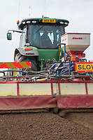 Cultivating & applying slug pellets -  Lincolnshire, May