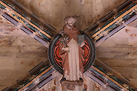 Bosse on the painted vaulted ceiling of a side chapel, by the Master of Rieux, with a monk holding a bible, in the 12th century cathedral of Saint Maurice de Mirepoix, Mirepoix, Ariege, Midi-Pyrenees, France. The cathedral was restored in the 19th century by Prosper Merimee et Eugene Viollet-le-Duc and is listed as a national monument. Picture by Manuel Cohen