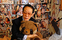 Issei Sagawa, the notorious Japanese cannibal, poses with his &quot;baby&quot; (a stuffed panda) next to erotic photo collages in his bedroom. The collages contain images of Western and Asian  women he has dated and photographed. Sagawa killed and ate  Dutch student Renee Hartevelt while studying in Paris in 1981. He was released in Japan due to political connections after being jailed then placed in a mental institution in Paris. <br /> 14-DEC-05