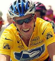 28.07.2002 US cyclist Lance Armstrong of the Postal Service team laughs during the final stage of the 89th Tour De France from Melun to Paris, 28 July 2002. With an outstanding lead of 7:17 minutes Armstrong confidently rode towards his fourth Tour De France victory in a row.