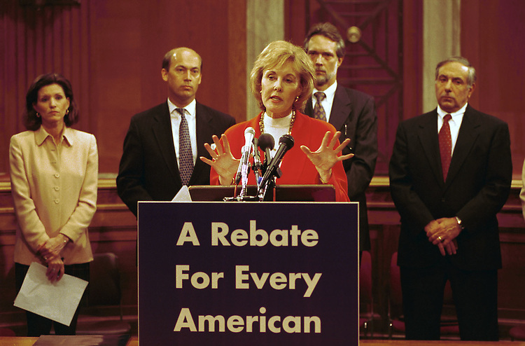 3/24/99.TAX NEWS CONFERENCE--Jennifer Dunn, R-Wash., during a news conference proposing that part of the surplus be refunded to tax payers. Second from left in background is Jerry Weller, R-Ill., flanked by lobbyists..CONGRESSIONAL QUARTERLY PHOTO BY SCOTT J. FERRELL
