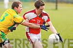 Rathmore's Michael O'Riordan controls the ball ahead of Gneeveguilla's Brendan Sheehan during their East Kerry Division 1 league final in Rathmore on Sunday.