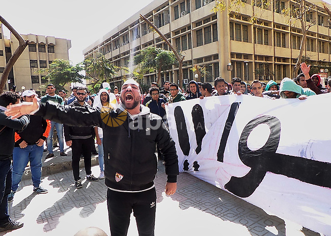"Al-Zamalek soccer club fans known as 'Ultras White Knights"" shout slogans during a protest against interior ministry after the riot that killed more than 20 soccer fans last month, at Cairo University on March 2, 2015. Photo by Amr Sayed"