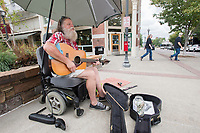 NWA Democrat-Gazette/J.T. WAMPLER Tim West of Fayetteville plays his guitar and sings Monday August 7, 2017 on the Fayetteville square. West likes to project his music down Block Ave because he likes the acoustics.
