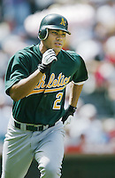 Carlos Pena of the Oakland Athletics runs the bases during a 2002 MLB season game against the Los Angeles Angels at Angel Stadium, in Anaheim, California. (Larry Goren/Four Seam Images)