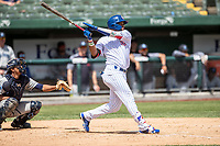 South Bend Cubs outfielder Jonathan Sierra (32) follows through on his swing against the Lake County Captains on May 30, 2019 at Four Winds Field in South Bend, Indiana. The Captains defeated the Cubs 5-1.  (Andrew Woolley/Four Seam Images)