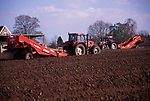 A913M3 Tractor and trailer planting potato crop in field Suffolk sandlings England