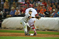 Wisconsin Timber Rattlers first baseman Alan Sharkey (18) stretches for a throw as Oscar Mercado (4) runs through the bag during a game against the Peoria Chiefs on August 21, 2015 at Dozer Park in Peoria, Illinois.  Wisconsin defeated Peoria 2-1.  (Mike Janes/Four Seam Images)