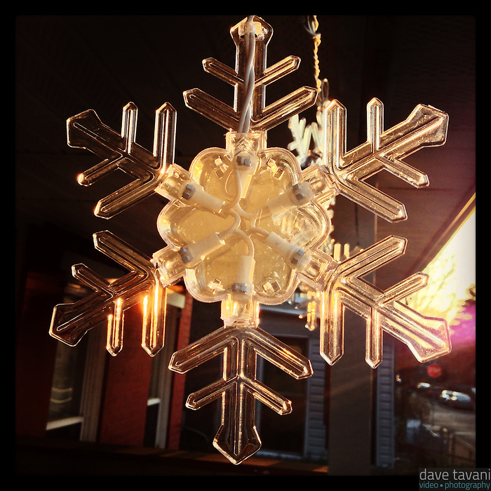 The sun illuminates a decorative snowflake on my neighbor's front porch on January 6, 2013.