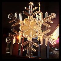 The sun illuminates a decorative snowflake on my neighbor's front porch on January 6, 2013.