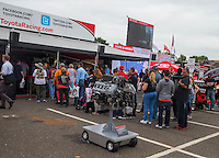 Jun 5, 2015; Englishtown, NJ, USA; Fans line up in the NHRA Toyota display for an autograph session during qualifying for the Summernationals at Old Bridge Township Raceway Park. Mandatory Credit: Mark J. Rebilas-