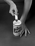 Pittsburgh PA: The New Schlitz Aluminum Softop Beer Can - 1962. Schiltz was the first national brewery to use the easy-open cans.  The trend was short-lived due to the introduction of the Alcoa pull-top can for Iron City Beer.  This was the beginning of the end for steel beer cans.