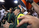 Oregon coach Mike Bellotti is soaked by his players as the Ducks celebrate a 64-38 win over the Beavers in the Civil War at Reser Stadium in Corvallis, November 29, 2008.