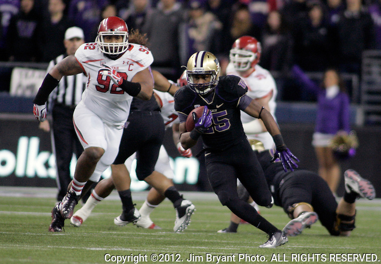 Washington Huskies running back Bishop Stankey runs past Utah Utes defense for a 17-yard gain at CenturyLink Field in Seattle, Washington on November10, 2012. Stankey rushed for 163 yards on 36 carries and scored two touchdowns in the Huskies 34-15 win over Utes.  ©2012. Jim Bryant Photo. All Rights Reserved.