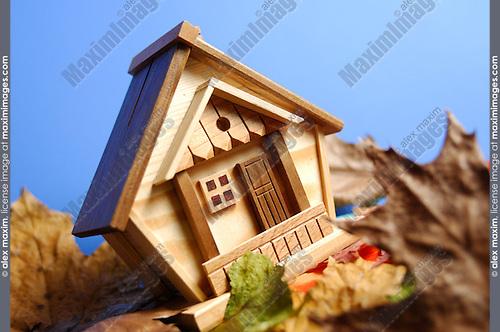 Little wooden house model under blue sky