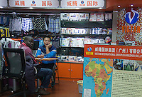 African and Chinese garment traders are seen in an area of Guangzhou known to locals as 'Chocolate City', Guangzhou, Guangdong Province, China, 08 December 2014. The health authorities of Guangzhou are said to be stepping up their monitoring of the African community in light of the ongoing outbreak of the Ebola virus disease in West Africa.