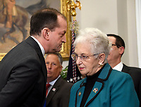 United States Secretary of Labor Alex Acosta, left, speaks with US Representative Virginia Foxx (Republican of North Carolina), Chair of the US House Education and Workforce Committee, prior to US President Donald J. Trump signing an Executive Order to promote healthcare choice and competition in the Roosevelt Room of the White House in Washington, DC on Thursday, October 12, 2017.  The President's controversial plan is designed to make lower-premium health insurance plans more widely available.<br /> Credit: Ron Sachs / Pool via CNP /MediaPunch