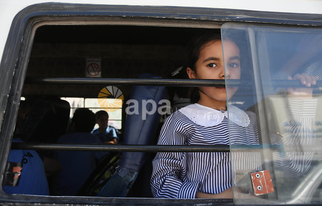 Palestinian students return back to their school in the morning of the first day of the new year study, in Gaza City on August 23, 2017. Photo by Mohammed Asad
