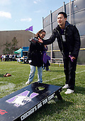 "Northwestern students play a game of ""corn hole"" in Wildcat Alley before the game against South Dakota"