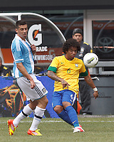 Brazil defender Marcelo (6) clears the ball as Argentina midfielder Jose Sosa (8) defends. In an international friendly (Clash of Titans), Argentina defeated Brazil, 4-3, at MetLife Stadium on June 9, 2012.