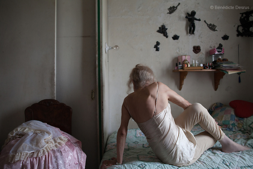 "August 26, 2013 - Mexico city, Mexico - Samantha practices her daily yoga in her bedroom in Mexico City. Samantha Flores is an 81-year-old transgender woman from Veracruz, Mexico. She is a prominent social activist for LGBTQI rights and is the founder of the non-profit organization ""Laetus Vitae"", a day shelter for elderly gay people in Mexico City. Senior citizens in general are many times prone to neglect and abandonment by their families, leaving them all but invisible. Their plight can be even worse if they are homosexual. Photo credit: Bénédicte Desrus"