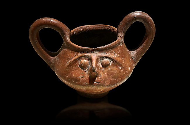 Hittite terra cotta double handled jug with a relief human face- 17th - 16th century BC - Hattusa ( Bogazkoy ) - Museum of Anatolian Civilisations, Ankara, Turkey . Against black background